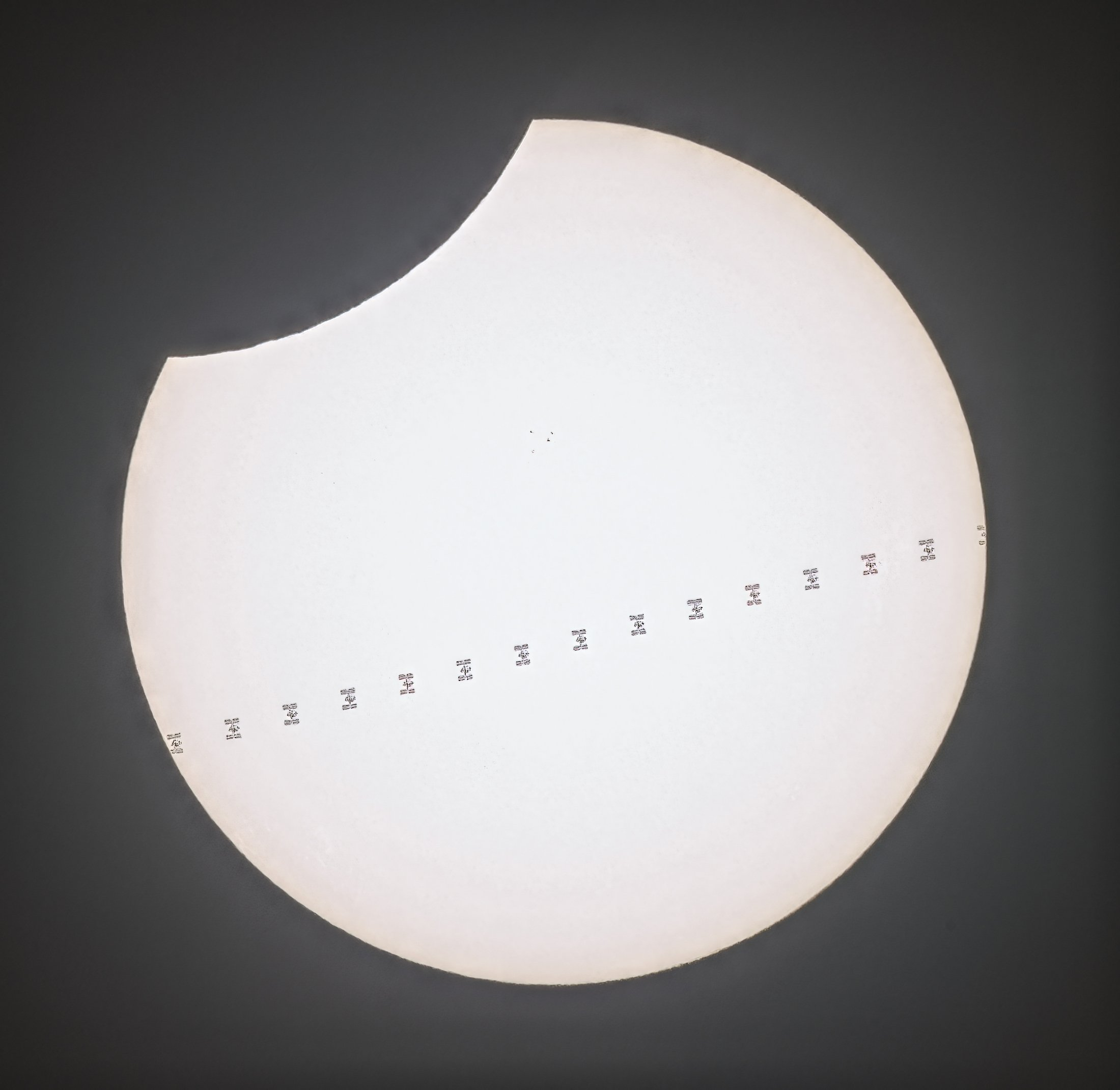 ISS in front of eclipse